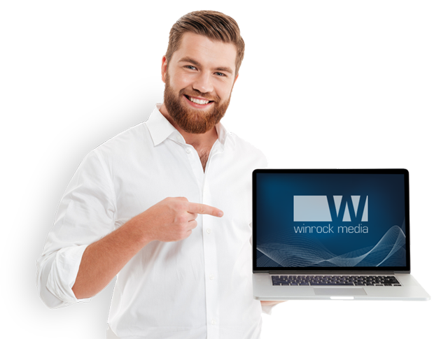 winrock media web designer showing website on laptop computer